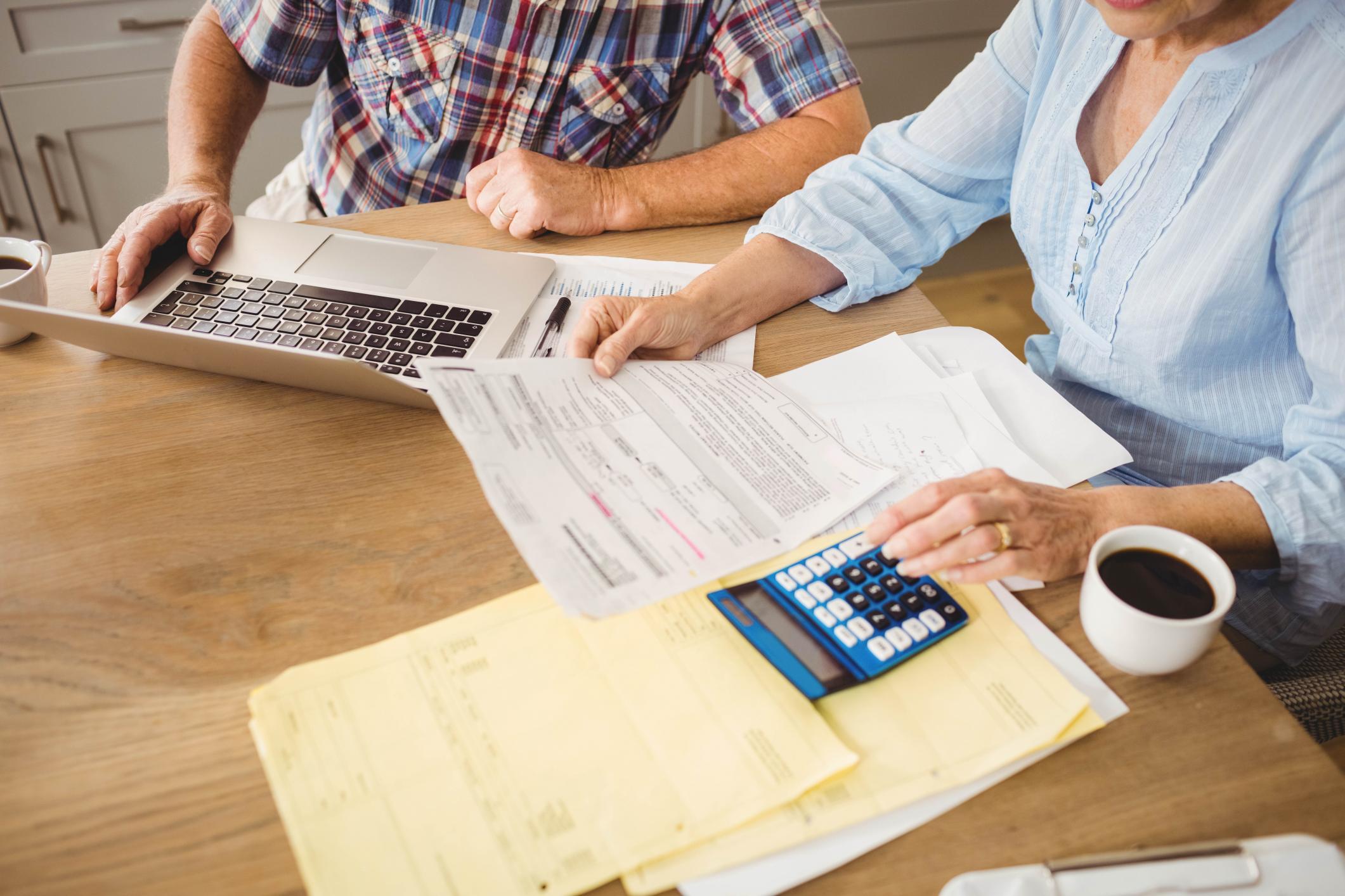 Elderly People Paying Bills